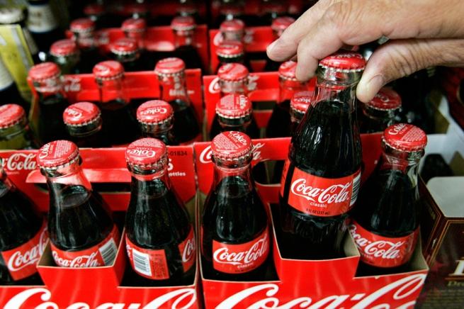 Coca-Cola сократила прибыль на 5%